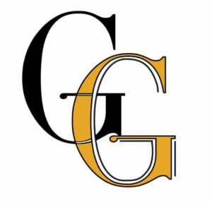 The Grand Gifts company logo that is two letter Gs overlapping. One is in black and the other is in a yellow-gold colour.